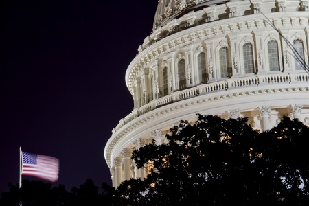 election night: US Capitol dome detail with American Flag at night - Washington DC USA, close up view  Stock Photo