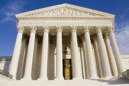 court: USA Supreme Court building in Washington, DC with a blue sky background   Stock Photo