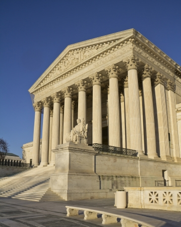 USA Supreme Court building in Washington, D C  with a blue sky background