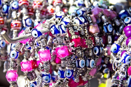 trinket: colorful bracelets with the evil eye good luck beads in a Turkish bazaar