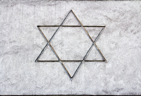 Star of David sketch on a cement wall  photo