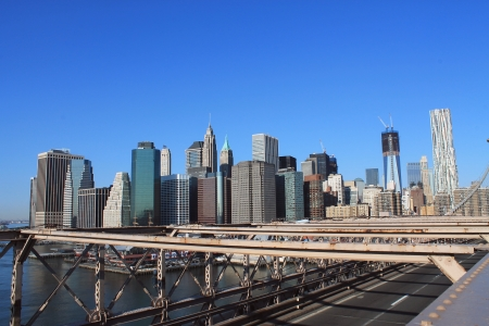 Lower Manhattan in the background of Brooklyn Bridge in a sunny morning, New York, United States  photo