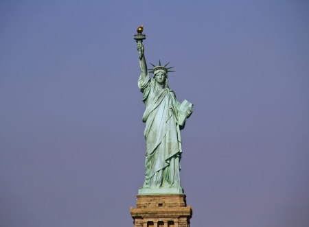 Statue of Liberty in cloudy winter day - New York City, United States  photo