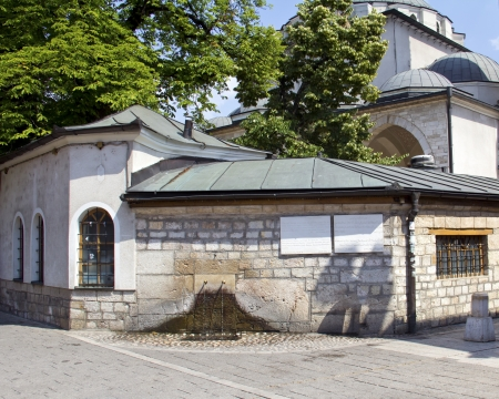 Sarajevo, Historic Gazi Husrev Mosque and fountain in the front in bascarsija, Bosnia an Herzegovina photo