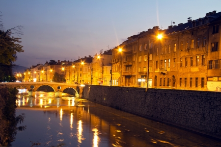 Miljacka river in Sarajevo the capital city of Bosnia and Herzegovina, at dusk photo