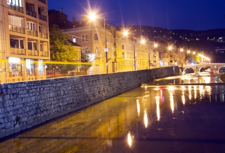 saraybosna: Miljacka river in Sarajevo the capital city of Bosnia and Herzegovina, at dusk Stock Photo