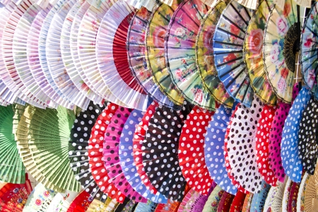 spanish culture: Colorful Spanish Fans arranged for sale in a store
