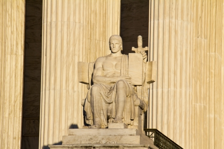 The statue called The Authority of Law at the entrance to the US Supreme Court in Washington, DC  photo