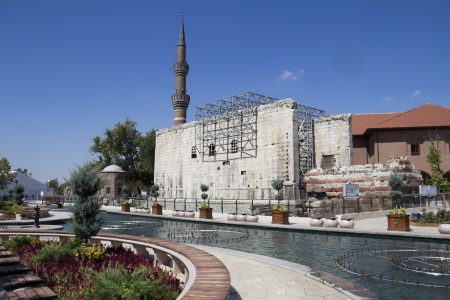 Historic famous Haci Bayram Mosque behind the historical site of Roman ruins in Ankara, Capital city of Turkey Stock Photo