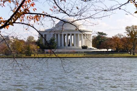 Washington DC, Thomas Jefferson Memorial in autumn with yellow tree branches foreground