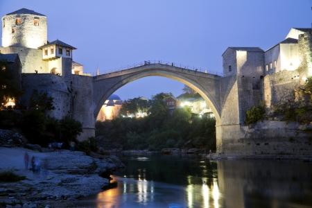 Mostar , Bosnia and Herzegovina , Old bridge at sunset  photo