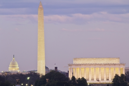 View of Washington DC with Capitol, Washington Monument and Lincoln Memorial, reflection on potomac river, at sunset