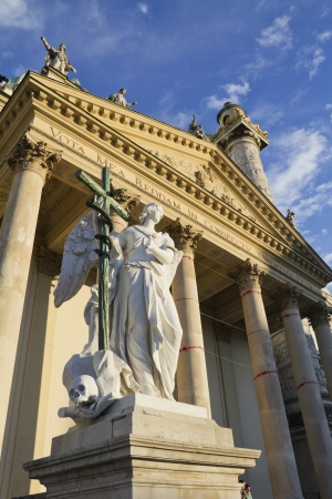 borromeo: Angel statue with cross in front of Karlskirche  St  Charles s Church , Vienna, Austria Stock Photo