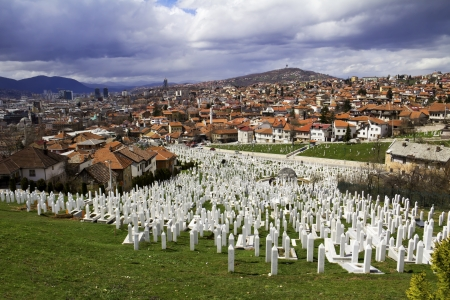 Muslim graveyard, matryrdom, under cloudy sky in Sarajevo , Bosnia and herzegovina  The Islamic religion is one of the three major religion in Bosnia   Stock Photo - 22134526