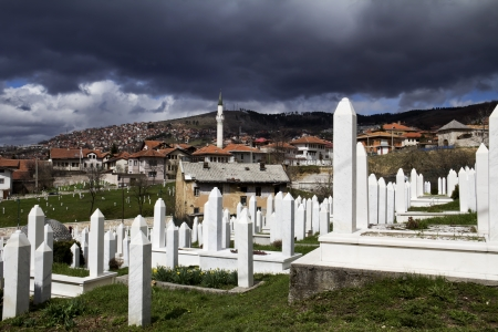 Muslim graveyard, matryrdom, under cloudy sky in Sarajevo , Bosnia and herzegovina  The Islamic religion is one of the three major religion in Bosnia   Stock Photo - 22134527