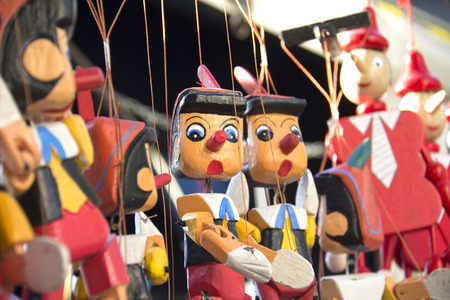 Painted wooden, the figure of Pinocchio  photo
