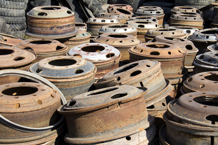 discarded: Stack of old discarded wheels