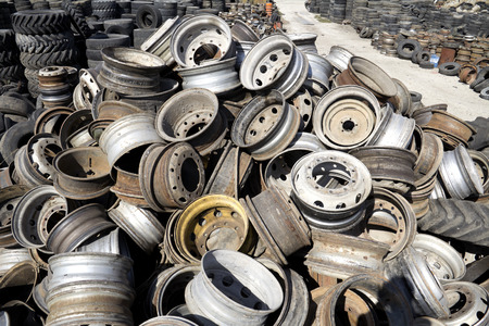 Stack of old discarded wheels