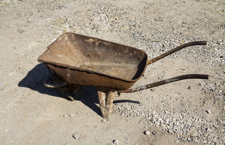Old wheelbarrow working tools in a construction photo
