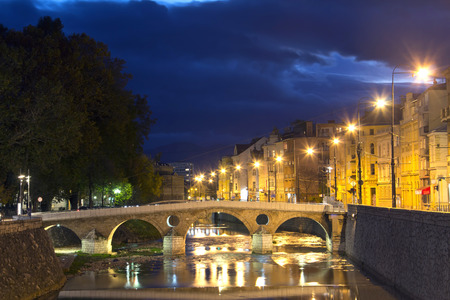 saraybosna: Latin bridge in Sarajevo the capital city of Bosnia and Herzegovina, at dusk Stock Photo