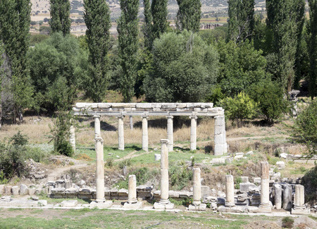 periods: South Agora town square detail with Ionic columns in Aphrodisias, Turkey build during Hellenistic and Roman periods. In Roman time it was a small city in Caria.