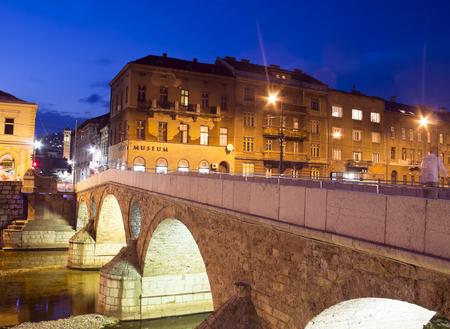 bosnia and hercegovina: Bridge on Miljacka river in Sarajevo the capital city of Bosnia and Herzegovina, at dusk Stock Photo