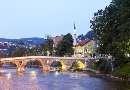 hercegovina: Bridge on Miljacka river in Sarajevo the capital city of Bosnia and Herzegovina, at dusk Stock Photo