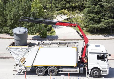 environmental sanitation: Recycling truck picking up bin - Horizontal Stock Photo