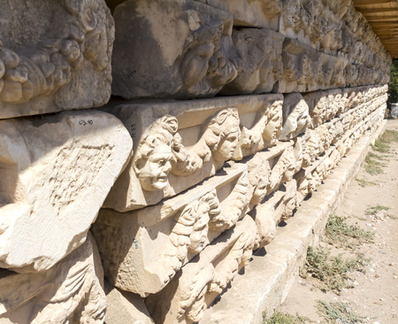 frieze: Aphrodisias Portico of Tiberius, faces in the decorative frieze, Geyre, Turkey