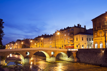 hercegovina: Latin bridge in Sarajevo the capital city of Bosnia and Herzegovina, at dusk Stock Photo