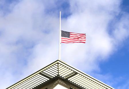 heros: Half mast American flag, on a cloudy day