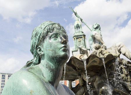 Neptune fountain in Berlin, Germany. Part of presenting sculpture of god Neptun fountain at the center and the crocodile in the water. Stock Photo