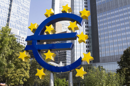 occupy wall street: FRANKFURT, GERMANY- SEP 10: The Famous Big Euro Sign at the European Central Bank. The bank was established by the Treaty of Amsterdam in 1998; September 10, 2016 in Frankfurt, Germany. Editorial