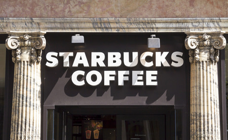 starbucks coffee: PARIS, FRANCE - AUGUST 6, 2016: Starbucks Coffee. Starbucks is the largest to coffeehouse company in the world, with 20.891 stores in 62 Countries. Editorial