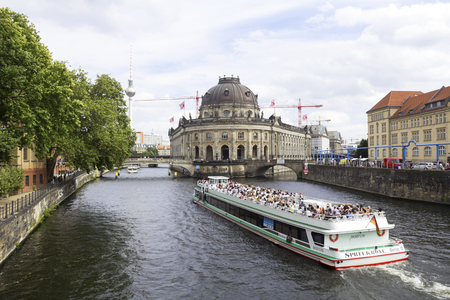 bode: BERLIN, AUGUST 13, 2016: The Bode Museum and the TV Tower in Berlin. Front view of the historical preserved building located in the Museum Island (currently under renovations). Editorial