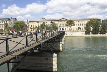 des: PARIS, FRANCE, The Pont des Arts or Passerelle des Arts bridge across the river Seine in Paris, France.
