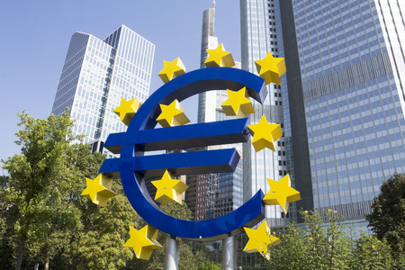 FRANKFURT, GERMANY: The Famous Big Euro Sign at the European Central Bank. The bank was established by the Treaty of Amsterdam in 1998; in Frankfurt, Germany.