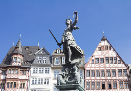 justitia: old town square Romerberg with Justitia statue in Frankfurt, Germany Stock Photo