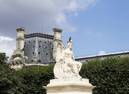 Ancient sculpture in the Tuileries garden - Garden located between the Louvre Museum and the Place de la Concorde, was created by Catherine de Medici in 1564. Editorial