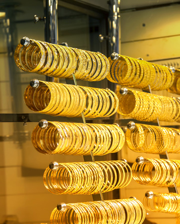 Rows of gold bracelets as a background in a jewelry store