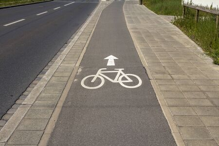 Sign of bicycle lane on asphalt road