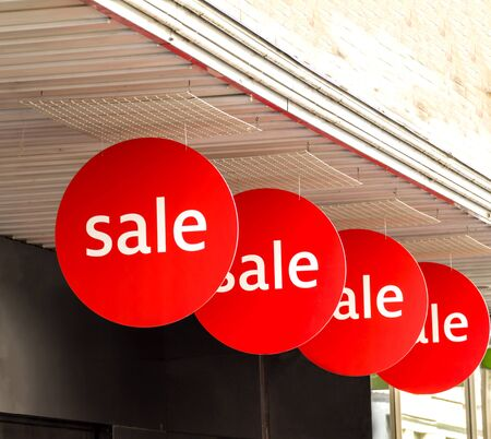 Sale signs in shop window at Basel shopping street