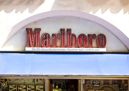 FURTH, Germany : Marlboro cigarette logo outside a shop. Marlboro is the best-selling brand of cigarettes in the world. It is made by Philip Morris