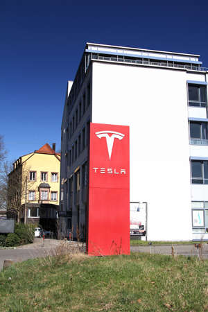 Nurnberg, Germany : Tesla Motors service center with multiple luxury Tesla cars inside. Tesla is an American company that designs, manufactures, and sells electric cars