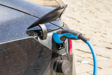 BAYREUTH, GERMANY - EV Car or Electric car at charging station with the power cable supply plugged in