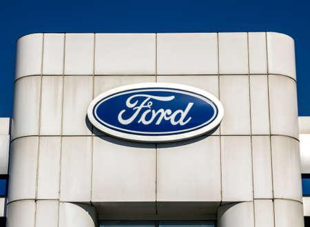 Izmir, Turkey : Ford dealership sign against blue sky