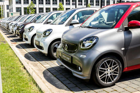 Nurnberg, Germany : A Smart Fortwo car exhibited in front of the Mercedes Benz dealership building with lined up Smart automobiles