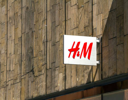 Hamburg, Germany: close up shot of H&M logo. H & M Hennes & Mauritz AB is a Swedish multinational retail-clothing company, known for its fast-fashion clothing