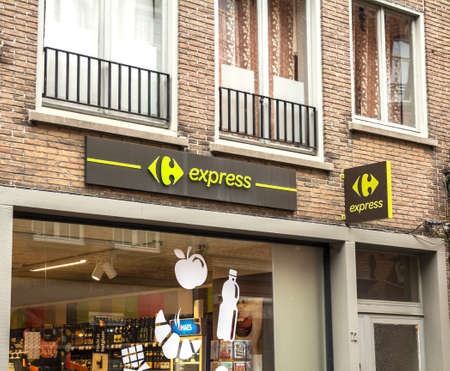 Bruges, Belgium : Store front sign - Carrefour Express (Super market / Proximity grocery store) Editorial