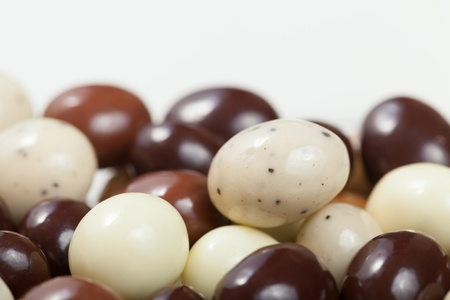 A macro shot of a variety chocolate covered espresso beans. Shallow DOF. photo
